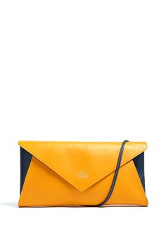 VIVIENNE WESTWOOD   OVERSIZED ENVELOPE CLUTCH IN TWO TONE LEATHER. Measures 42cm x 21cm x 6cm. 100% leather.