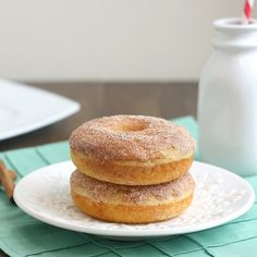 1 1/2 teaspoons cinnamon  1/3 cup sugar   1 cup cake flour  3/4 teaspoon baking powder  3/4 teaspoon baking soda  pinch of salt  1 large egg  1 (6 oz) container of non-fat vanilla Greek yogurt  1 tablespoon canola oil  2 teaspoons lemon juice  2 1/2 tablespoons maple syrup  1 tablespoon unsalted butter, melted    Preheat oven to 400 F.