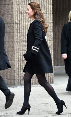 Tinker tailored: The Duchess of Cambridge, pictured arriving at the Northside Center for Child Development in Harlem this morning, appeared to have altered her $1,000 Goat coat to make it longer