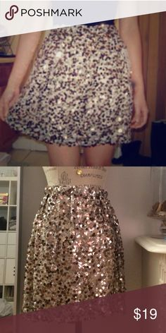 Gold Sequin Skirt Brand new with tags taupe skirt with all-over gold sequins. Elastic waist. Shell: 100% nylon. Lining: 100% polyester. Joe Fresh Skirts