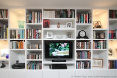 Bespoke shelving unit with symmetrical but thick random shelves, contemporary style with books and ornaments