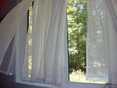 watching lace curtains blowing in the breeze, gentle and feminine