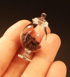 Miniature chocolate truffles in a glass jar.