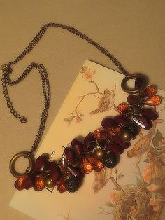 Necklace with lots of beads.   More information given on my website http://barbspencerdolls.com If you are overcharged on shipping costs, I make refunds.