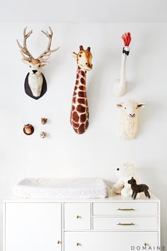 Nursery with faux animal heads mounted on wall