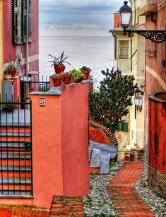 Why does a house this color look so pretty - as long as it isn't next door?Down to the Sea, Genoa, Italy   photo via pixdaus.