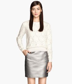 Pair a white lace long-sleeve top with a metallic silver skirt for the perfect work-to-play ensemble. | H&M Modern Classics