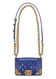 Chanel Royal blue patent leather     love the details on the corners of the bag