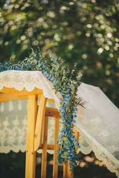 Greenery and Lace Ceremony Arch Decor | Photo: Yes, Dear. Studio |