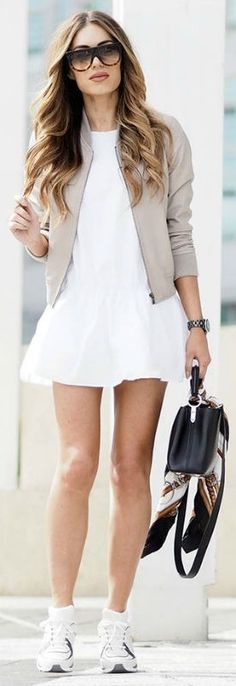 Bomber jacket trend + beige + over white mini dress + simple sneakers + Lydia Lise Millen + sporty chic style + shades and a leather bag + perfect for summer Dress: Zara, Jacket: ME+EM, Trainers: Chanel, Scarf: Gucci, Bag: Louis Vuitton.