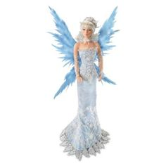 18-inch fairy doll by artist Cindy McClure represents ice. Handcrafted in fine porcelain with poseable wings, fabric costume with simulated jewels.