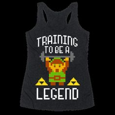 Workout women's racer tank. Channel the strength of the mighty hero of Hyrule! You may not be burdened with the responsibility to save Princess Zelda and rid Hyrule of all evil, but you can at least get to the gym and get fit! Get your fitness on and workout to this super nerdy, fitness and video game inspired, Legend of Zelda shirt!