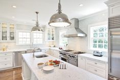 shaped kitchen design with Restoration Hardware Harmon Pendants over endless…
