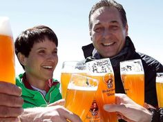 Frauke Petry (L), chairwoman of the anti-immigration party Alternative for Germany (AfD), and head of the Austrian Freedom Party (FPOe) Heinz-Christian Strache toast with beer at Germany's highest mountain, the Zugspitze, in Grainau near Garmisch-Partenkirchen, Germany, June 10, 2016.    REUTERS/Michaela Rehle