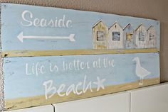 Beach signs with beach huts and saying -Life is better at the beach. More beach signs here: http://www.completely-coastal.com/2012/03/diy-recycled-wood-beach-signs.html