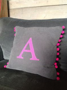 Bright & colourful letter/initial, handmade personalised cushion with Pom Pom trim. by LiviluHome on Etsy https://www.etsy.com/listing/186842599/bright-colourful-letterinitial-handmade