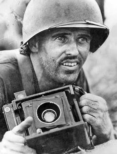 Art Rogers in a foxhole in Leyte, Philippines WWII. So many war photos came from this man's camera.