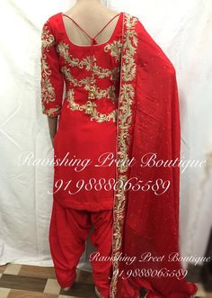 New designer suit with victorian motifs designed by Ravishing Preet Boutique