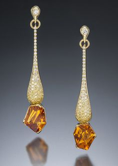 Dripping Diamond earrings exude warmth and scintillation. This unique earring design features two exceptional Munsteiner-cut Mandarin garnets totaling 2.94 carats set in 14 karat yellow gold with .20 carats of VS G-F diamonds and .40 carats of canary diamonds