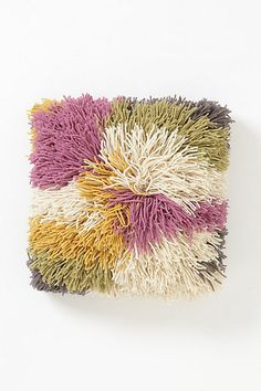 Love the colors on this pillow from Anthropologie. Saw it in store - it's huge! A trip to the craft store, 5 colors of bulky wool yarn + a latch hook and I could make my own. It would also make a great color scheme for a chevron knit scarf.