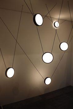 An arrangement of suspended lights is an artful installation. Suspended Lighting, Cool Lighting, Lighting Ideas, Track Lighting, Design Studio, Interior Lighting, Floor Lamp, Creative Design, Designer