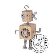 Holzroboter. Das ist mal ein Hingucker! Ein Roboter aus Holz und Metall. Ganz einfach zu basteln mit der Basteltüte.