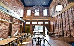 Sure, Boundary Road is a clear newcomer, but it's easily one of the prettiest restaurants on the revitalizing H Street NE strip. It's also one of the best renditions of today's trend of taking exposed brick, reclaimed wood and other vintage items — like that mattress spring light fixture created by a local artist — in designing a restaurant.  [Photo: