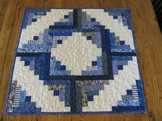 I love to make scrappy items and the Log Cabin block is my favorite, so with that said here are my two favorites in one. This log cabin table