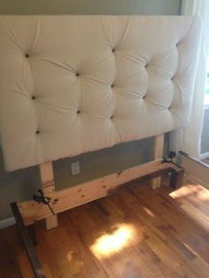 Great tutorial on how to make the headboard and also a wood frame if you're so inclined!
