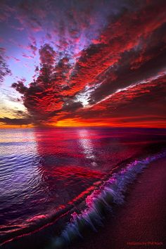 Sunrise on the shore of Lake Michigan.  Wisconsin Horizons By Phil Koch.