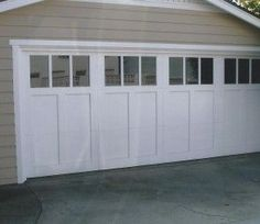 Traditional craftsman garage door featuring clear glass with vertical mullions