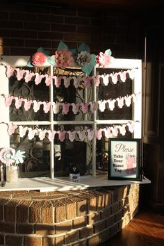 Baby Shower Name Tags displayed on vintage window