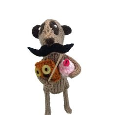 EtsyKat knitted meerkat with mustache on a stick by niftyknits, £27.00