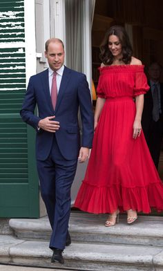 For a birthday party celebrating the Queen, Kate switched into a red Alexander McQueen dress with off-the shoulder sleeves. Photo: Getty Images The Duchess debuted a variety of new looks in Europe. Mode Outfits, Dress Outfits, Fashion Dresses, Prom Dresses, Summer Dresses, Long Dresses, Dress Long, Looks Kate Middleton, Alexander Mcqueen Dresses