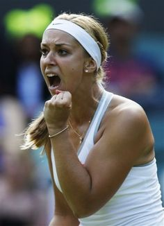 Sabine Lisicki of Germany reacts after winning a point against Samantha Stosur of Australia during their Women's singles match at the All England Lawn Tennis Championships in Wimbledon, London, Saturday, June 29, 2013. (AP Photo/Sang Tan)