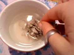 How To Clean Your Silver Jewelry: 2 Tb baking soda and 1/2 C water - put silver jewelry in for 20 min. Take out and rub with clean towel soaked in water. Dry it and you're done!