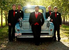 Some men prefer to bring their toys to the party. Black tuxes with red underneath proves to be a classic look, especially when posing with this antique truck, in the aisle of birch trees.  Photo Credit: Brittany McConnell Photography