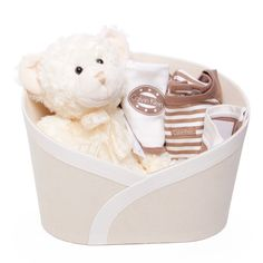 Adorable teddy in a faux suede hamper box packed with Calvin Klein outfits.