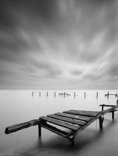 a run-down dock rising from the water