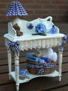 miniatures in blue & white on a white table