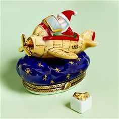 Limoges Santa on Airplane Box with Gift.