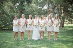 The bridesmaids wore short lace dresses in a variety of styles.  Vintage Spring Wedding Ideas - Heart Love Weddings