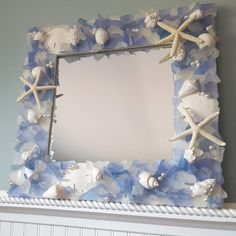 Arrisan handmade sea glass mirror in Blue, but available in many colors and custom sizes. Perfect beach glass mirror for coastal or beach nautical home decor, or makes a beautiful gift! Sea Glass Decor, Sea Glass Art, Beach Crafts For Kids, Dorm Door Decorations, Beach Wedding Gifts, Handmade Mirrors, Heart Wall, Beach House Decor, Coastal Decor