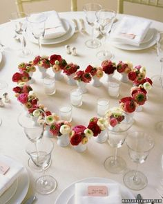 Give petite flowers a larger presence by arranging them in the form of a heart. With this centerpiece there are enough blooms for every guest to take a cluster or two home.