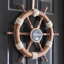 What a charming, coastal entryway! How to create a Nautical Wreath from an Old Ship Helm!