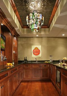 eclectic basement by Craig Custom Builders. Love the ceiling tiles and the light