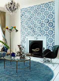 blue and white tiled fireplace becomes the focal point of the living room. Fireplace Wall, Fireplace Surrounds, Fireplace Design, Fireplace Update, Rachel House, Chimney Breast, Dream Decor, Living Room Inspiration, Home Living Room