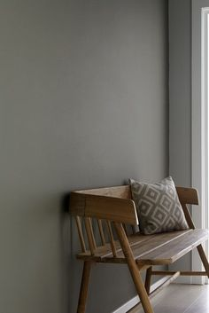 grey hall with wooden bench