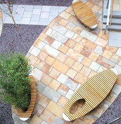 Oval Seat: Lime Grove Court, Manchester University - by Woodscape. Bespoke Hardwood street furniture.