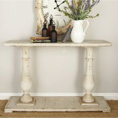 Perfect for displaying a vase of lush blooms or an exotic candle arrangement, this fir wood console table showcases turned details and a weathered finish. Repurposed Furniture, Cool Furniture, Entry Furniture, Dream Furniture, Repurposed Wood, Handmade Furniture, Eggshell White Paint, Wooden Console Table, Console Tables